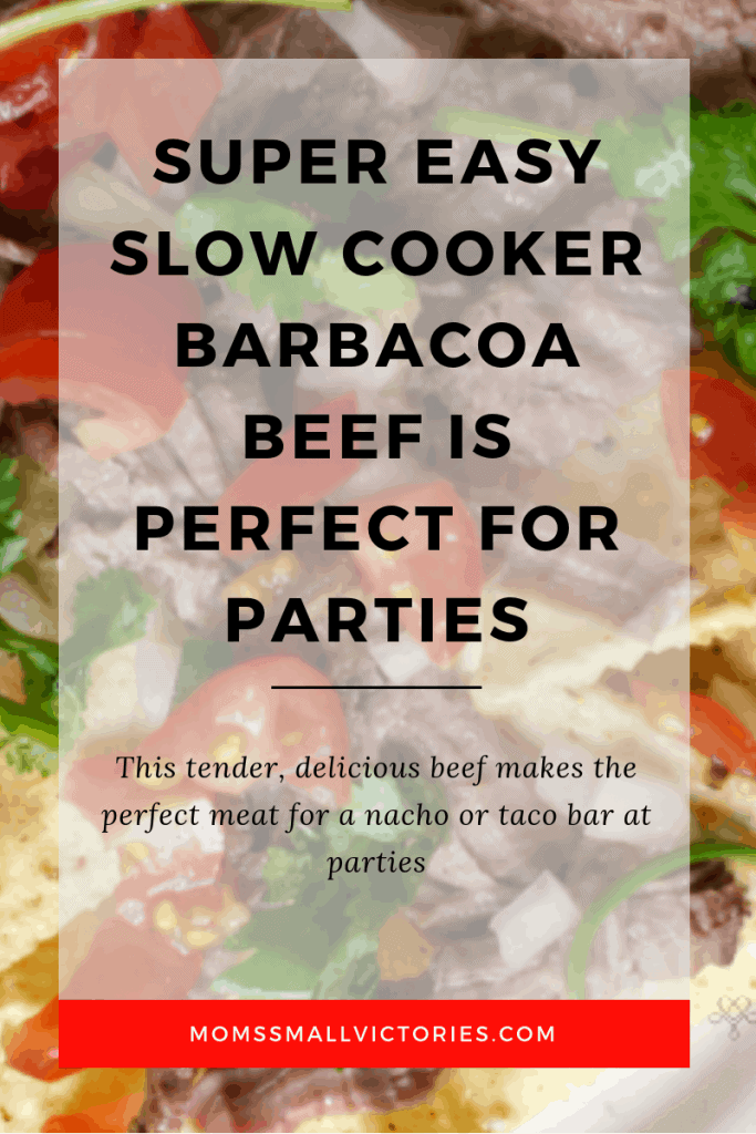super easy slow cooker barbocoa beef nachos closeup on a plate. makes the perfect meat for a taco or nacho bar at parties