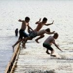 action-shot-jumping-off-the-dock