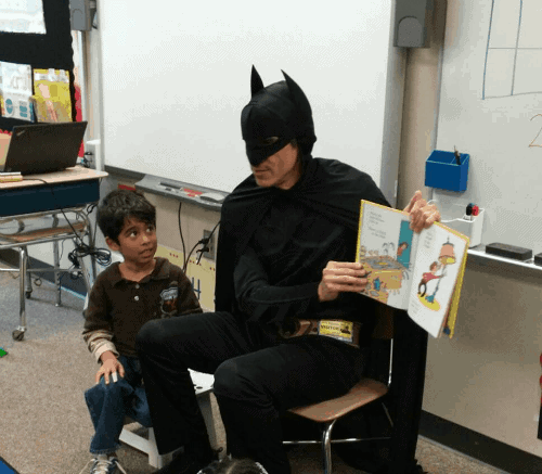 "My Superhubby dressed as Batman to read Dr. Seuss' There's a Wocket in My Pocket to my youngest son's class. He totally stayed in character and I love my little guy's expression who's looking at his dad like ""Dad, what happened to your voice?"""