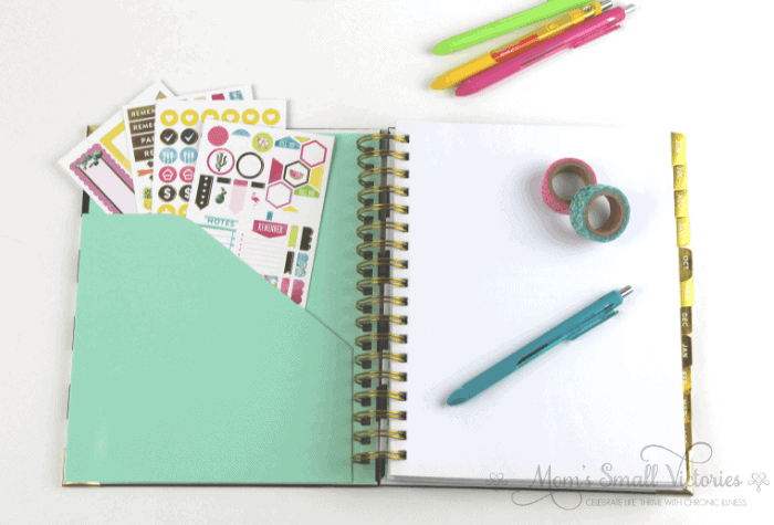 Day designer planner review inside pocket picture with sticker sheets in pocket and colorful pens and washi tape