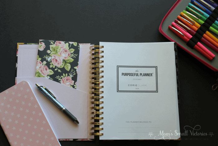 The inside front cover of the Purposeful Planner has a pale pink pocket to keep stickers, notes or a small journal. The title page has space for you to write your name and information.