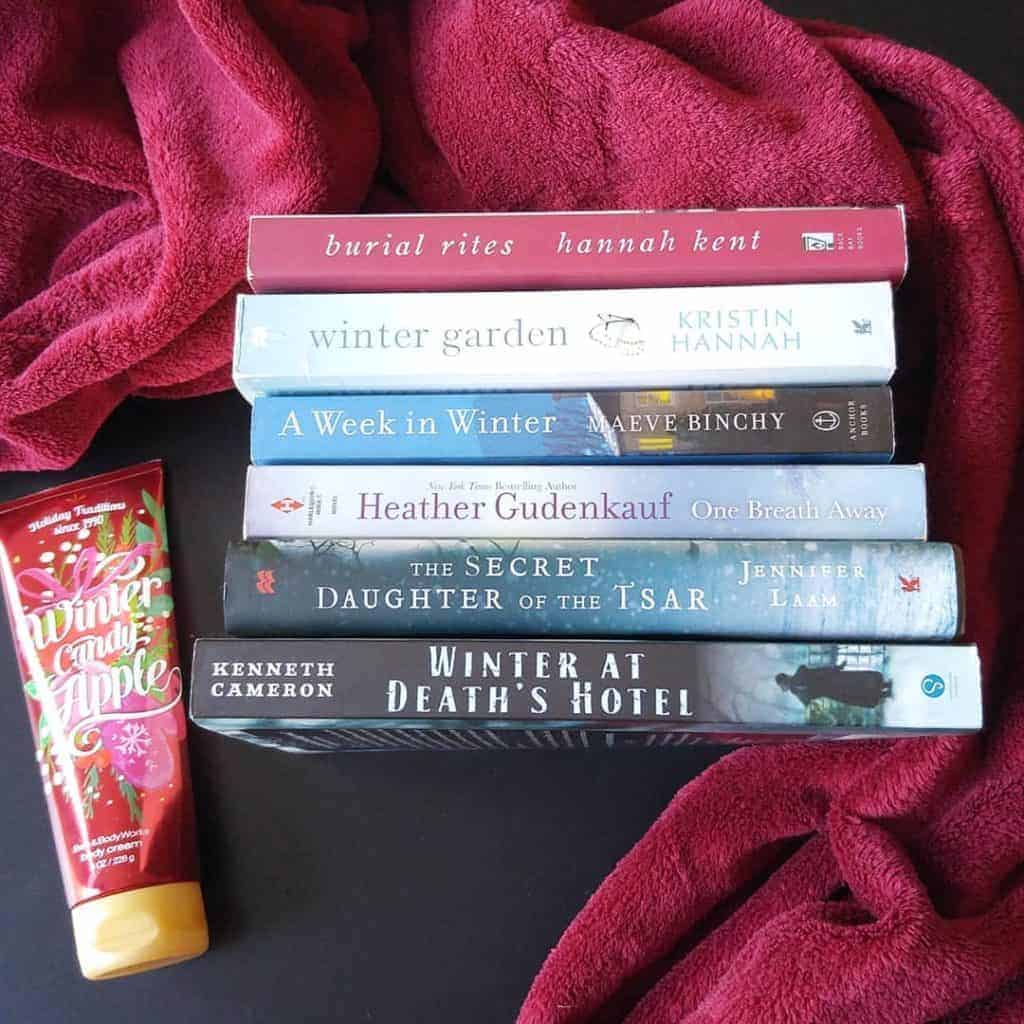 Reading challenge ideas: Ready for a change of seasons or need a break from the cold of winter and the stifling heat of summer? Pick a seasonal reading challenge. Pictured are some of the books on my Ultimate Winter Reading List!